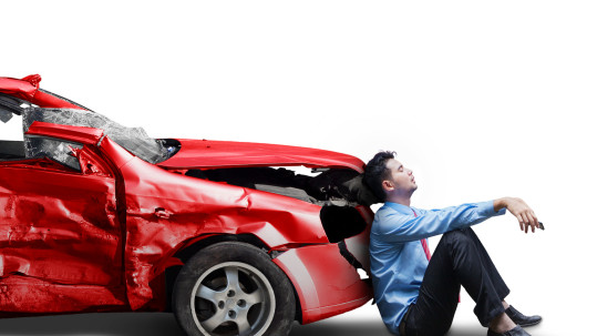 Picture of frustrated businessman with broken car after traffic accident, isolated on white background
